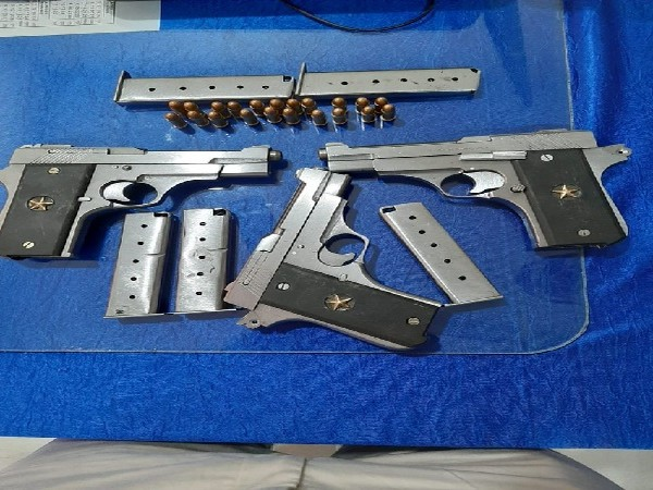 The automatic pistols and magazines recovered from college student in Bhubaneswar, Odisha.