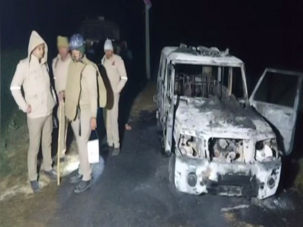 Visuals from the site where locals torched a police vehicle (Photo/ANI)