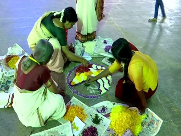 Participants making 'Athapookalam' on the occasion of Onam on Tuesday in Thiruvananthapuram. Photo/ANI