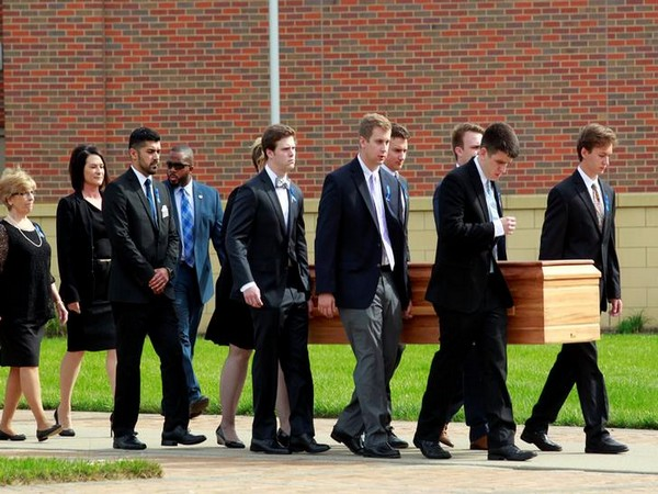 The casket of Otto Warmbier being carried to the hearse in Ohio, US in 2017 (Photo/Reuters)