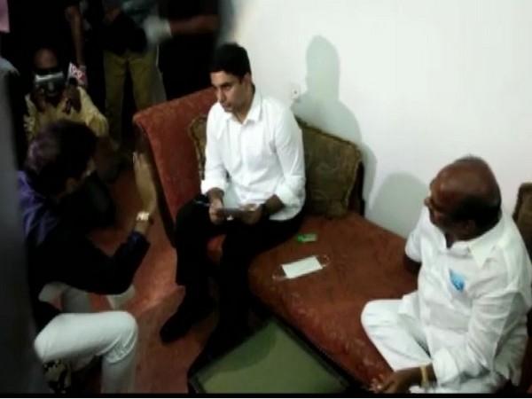 TDP general secretary Nara Lokesh interacting with family members of JC Prabhakar Reddy in Anantapuram on Monday. (Photo/ANI)