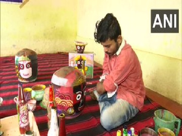 Visuals of Prabhakar Pradhan in Odisha who follows passion for painting after losing both hands in accident (Photo/ANI)