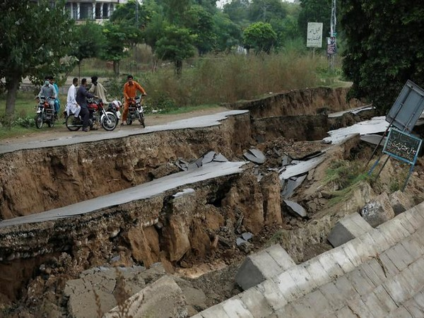 People on bikes gather near a damaged road after an earthquake in Mirpur on Wednesday. Photo/ANI