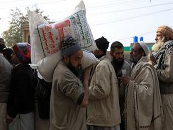 People queue up to purchase wheat flour in Pakistan