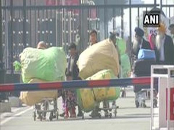 The Pakistani Hindu families crossing the border to enter India on Monday. Phot/ANI