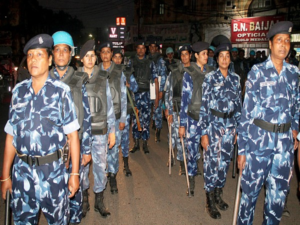 Rapid Action Force personnel flag march in Lucknow on November 8. (ANI Photo)