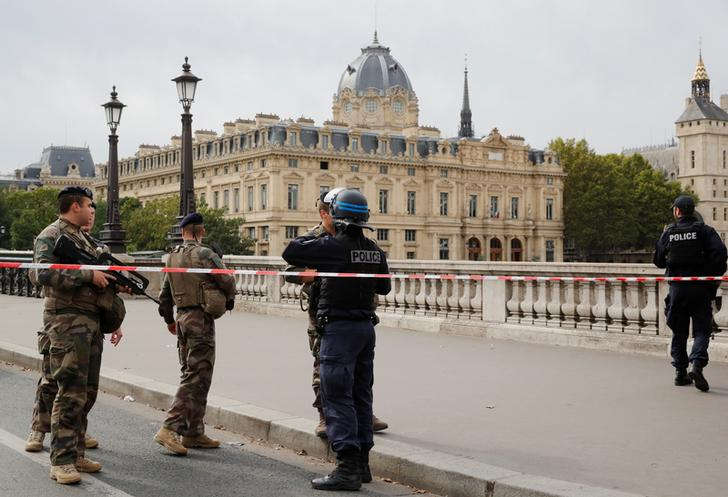 Officials outside the police headquarters in Paris on Thursday