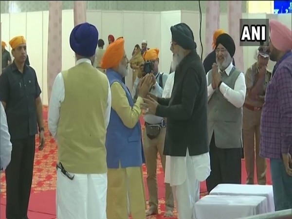 PM Narendra Modi with Parkash Singh Badal in Gurdaspur on Saturday (Photo/ANI)