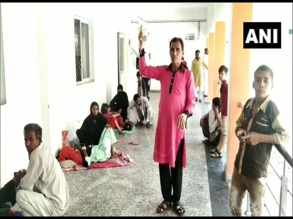 atients being treated on the floor at Rampur District Hospital.