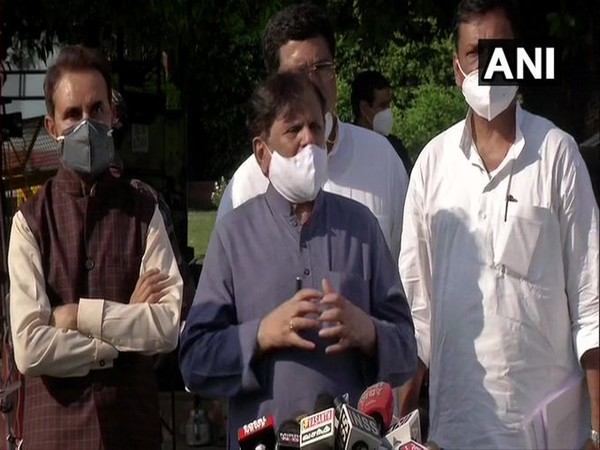 Congress MP Ahmed Patel speaking to reporters in New Delhi on Sunday.