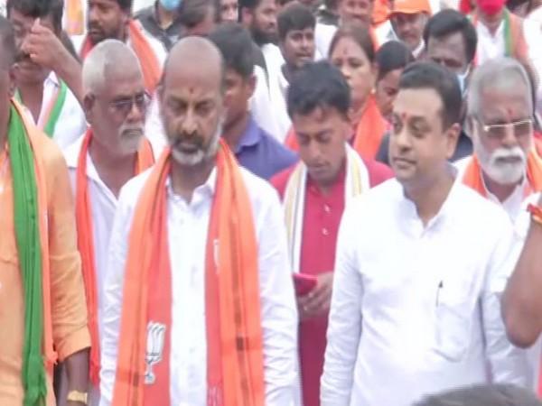 BJP's  Sambit Patra and Bandi Sanjay during Praja Sangrama Yatra. (Photo/ ANI)