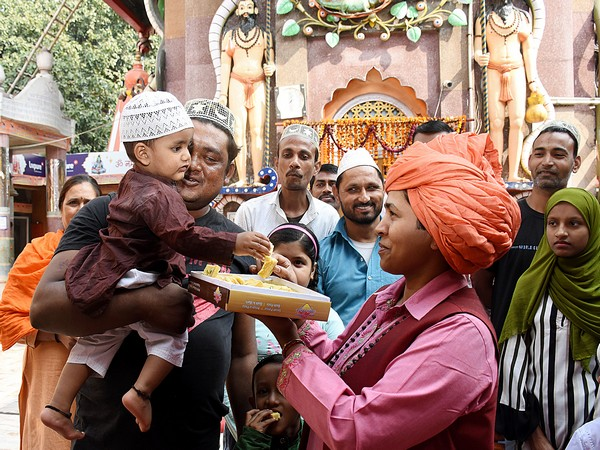 Mahant of Mankameshwar temple Devyagiri celebrates with Muslims after the Ayodhya verdict at Mankameshwar Temple in Lucknow on Saturday. ANI/Photo