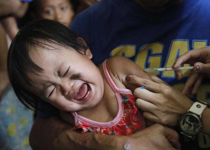 A child getting vaccinated against measles in Manila, Philippines in 2014.