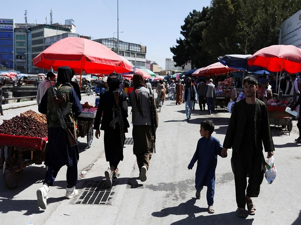 Taliban fighters walk on a street in Kabul. (Photo Credit - Reuters)