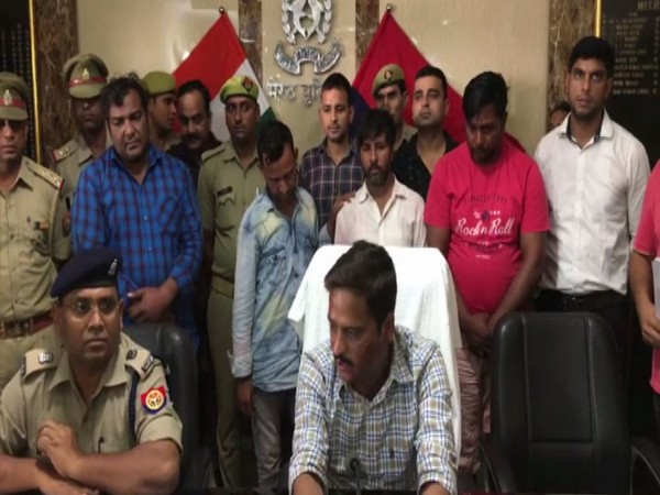 The Meerut police in Uttar Pradesh with four arrested on Sunday. Photo/ANI