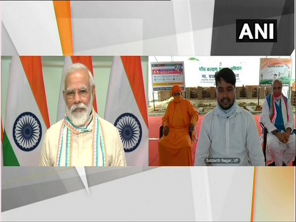Prime Minister Narendra Modi interacting with people via video conferencing on Friday. [Photo/ANI]