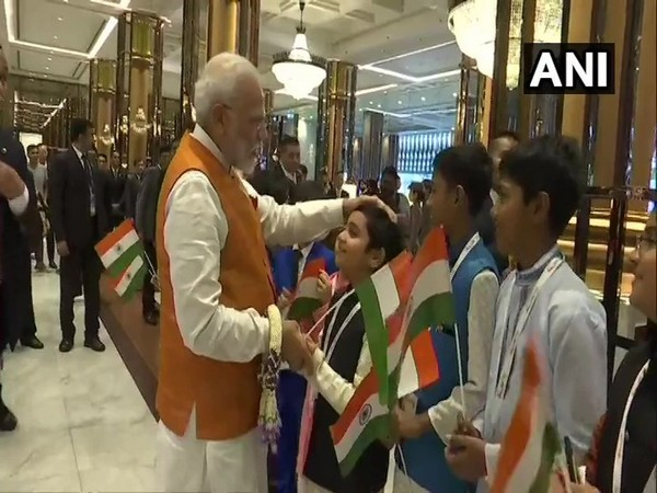 PM Modi was seen interacting with children gathered at the hotel Marriott Marquis in Bangkok on Saturday