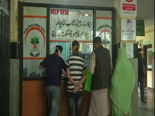 People gathered at a hospital in Poonch to avail the benefits of Golden card. (Photo/ANI)