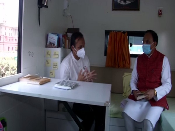 Ramesh Pokhriyal riding Energy Swaraj Yatra Bus (Photo/ ANI)