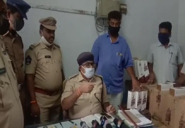 Excise department police with seized liquor in Prakasam, Andhra Pradesh.
