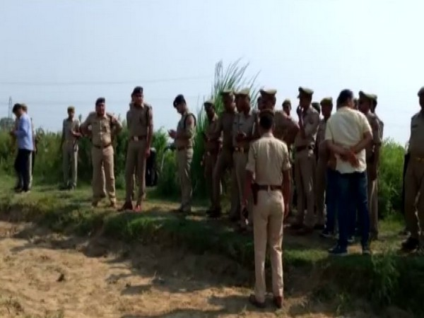 UP Police team on the field where dead bodies were recovered. (Photo/ANI)