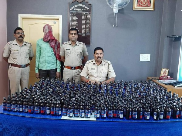 West Bengal police with the accused and seized bottles of Phensedyl. Photo Credit: West Bengal Police Twitter handle