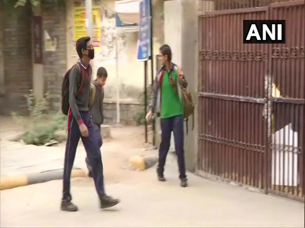 Students wear anti-pollution masks to schools,  as the air quality continues to be poor in Delhi.