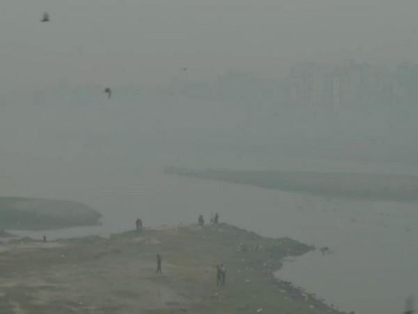 Thick layer of smog envelops the Delhi's Wazirabad area on Thursday.
