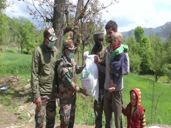 Members of the Indian Army distributing rations to poor in Poonch on Friday