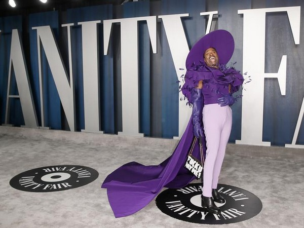 Billy was seen donning a purple feather blouse and a cape of the same color (Photo Courtesy:  Reuters)