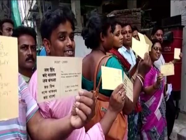 TMC workers sending postcards to Prime Minister Narendra Modi at Dum Dum on Tuesday. Photo/ANI