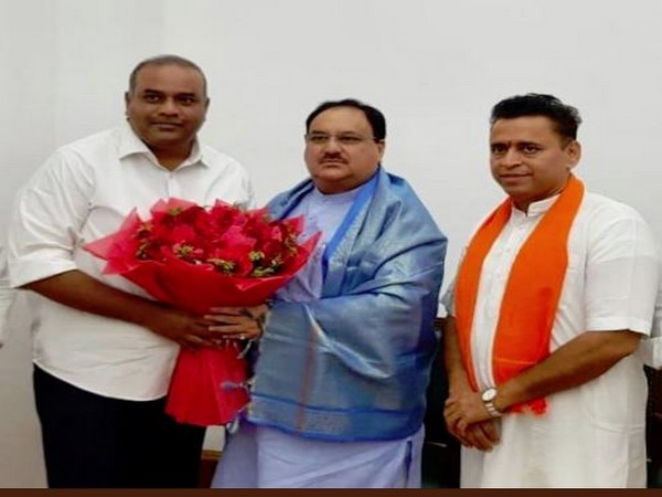 TDP Member of Legislate Council (MLC) Annam Satish Prabhakar (L) with BJP working president JP Nadda (centre). Photo/ANI