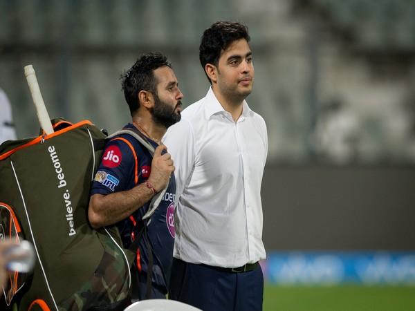 Wicket-keeper batsman Parthiv Patel with Mumbai Indians owner Akash Ambani