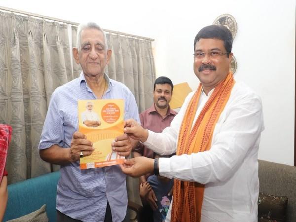 Union Minister Dharmendra Pradhan on right meeting with poet Ramakanta Rath in Bhubaneswar, Odisha on Saturday.