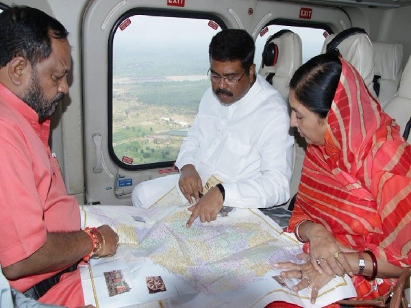 Union Minister Dharmendra Pradhan conducting an aerial survey of flood situation in Odisha on August 17. Image Courtesy: Twitter