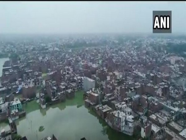 Buildings in low-lying areas of Prayagraj partially submerged due to heavy downpour [Photo/ANI]