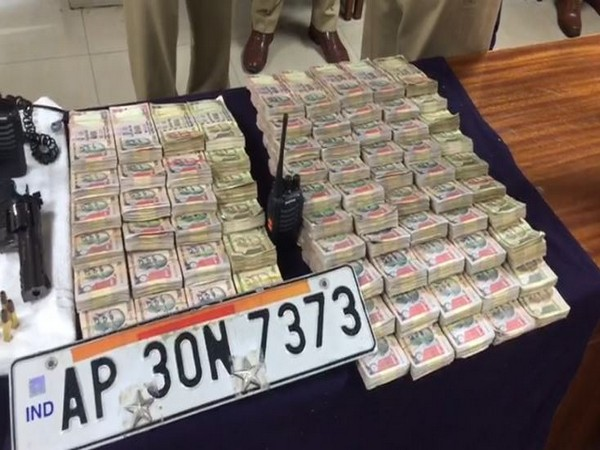 Fake police number plate and old currency recovered by police. Photo/ANI