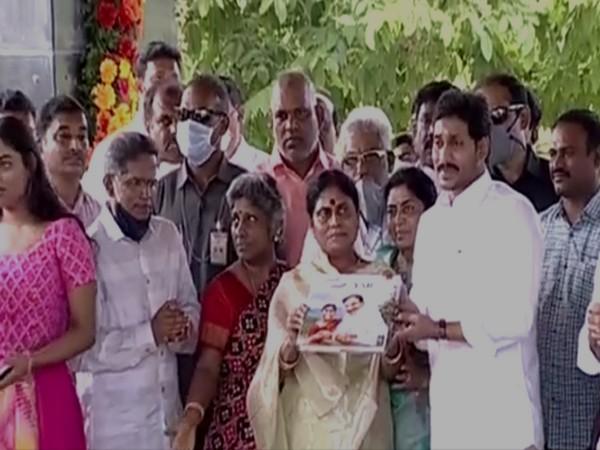 "Andhra Pradesh CM YS Jagan released the book ""Nallo Nathu YSR"" written by his mother YS Vijaya Lakshmi [Photo/ANI]"