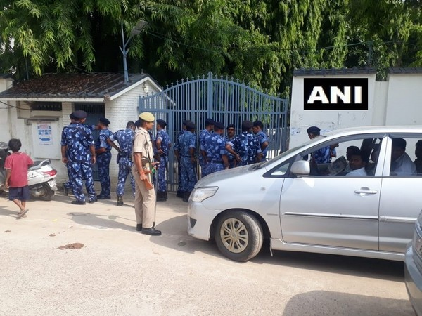 Police and Rapid Action Force personnel outside the residence of former Samajwadi Party MP Atiq Ahmed.