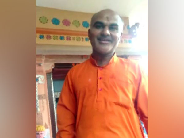The priest who stopped a Dalit man has been taken into custody.