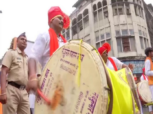 Traditionally dressed inmates of Yerwada Central Jail play drums during the Ganpati procession