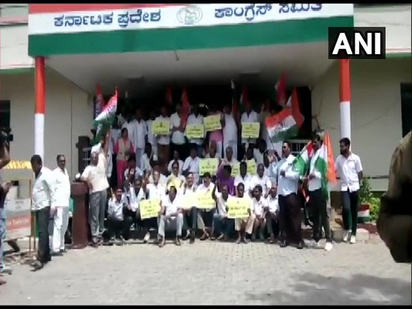 Congress workers during their protest outside KPCC office on Sunday in Bengaluru. (Photo: ANI)