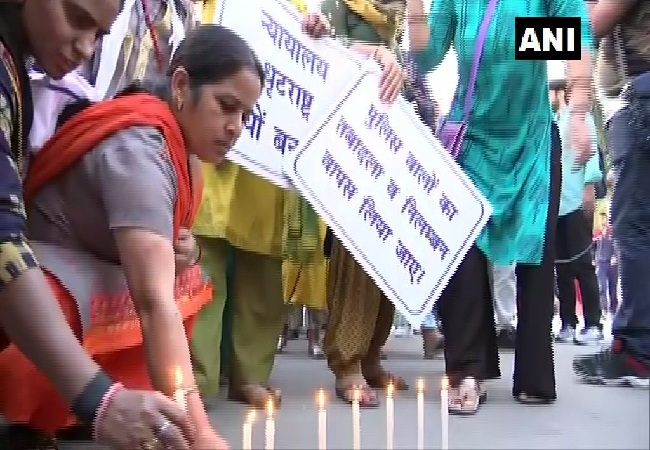 Families of policemen protest in New Delhi on Tuesday.