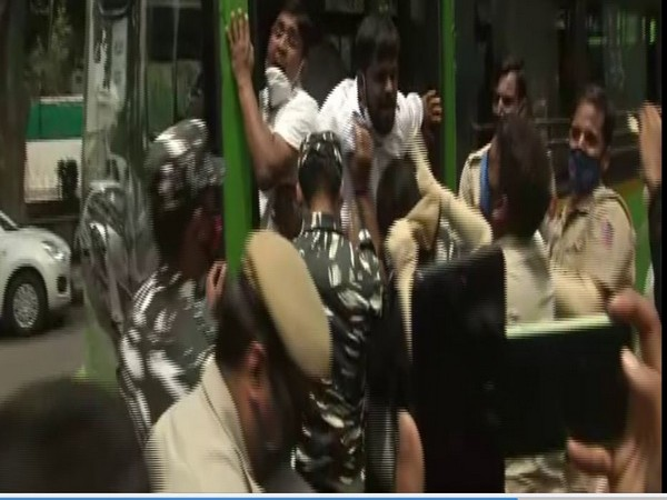 The police personnel were trying to clear the area and putting protestors inside a bus. (Photo: ANI)