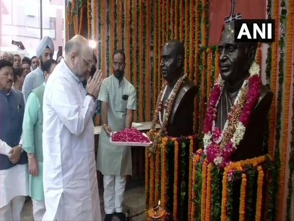 Amit Shah paid tributes to Pt Deen Dayal Upadhyaya and Syama Prasad Mukherjee at BJP Headquarter. (Photo/ANI)