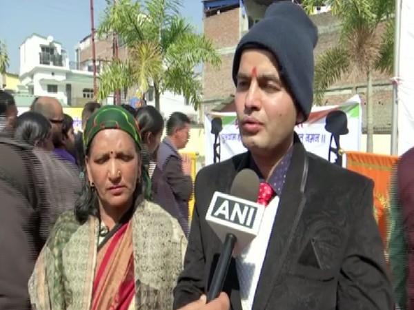 Martyr Mohanlal Raturi's wife Savita Devi with her son-in-law Sarvesh Nautiyal.