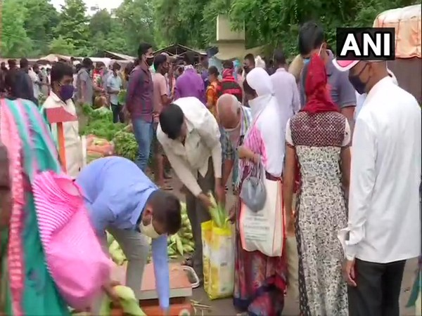 People at a vegetable market in Pune today ahead of 10-day lockdown. (Photo/ANI)