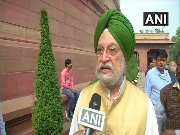 Civil Aviation Minister Hardeep Singh Puri speaking to reporters in New Delhi on Wednesday.