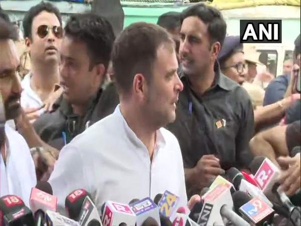 Rahul Gandhi speaking to reporters after coming out of court on Patna on Saturday.