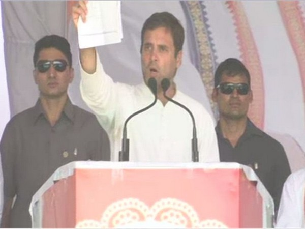 Congress president Rahul Gandhi showing documents while addressing a public rally in Ujjain on Tuesday. Photo/ANI